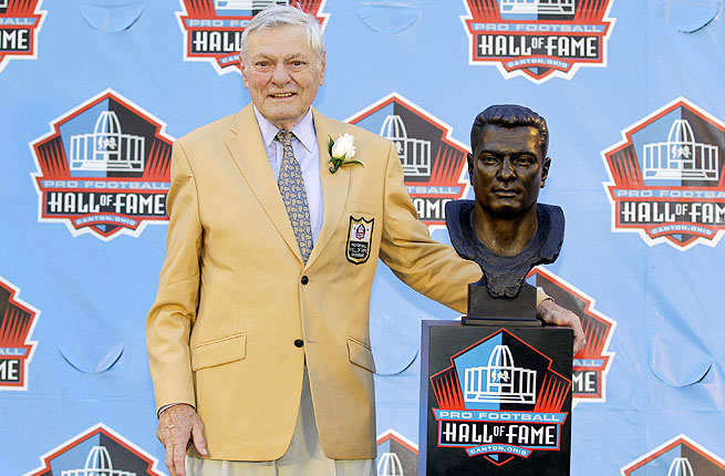 Jack Butler poses with a bust of himself during an induction ceremony at the Pro Football Hall of Fame in 2012.