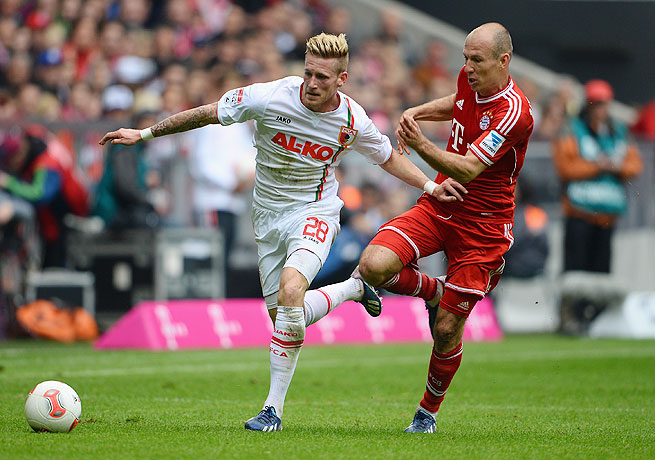 Arjen Robben (right) and Bayern suffered no champion's comedown as they dispatched Augsburg.