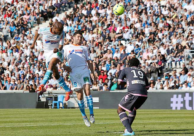 Andre Ayew (left) scored both of Marseille's goals, including this tally on a header in the first half.