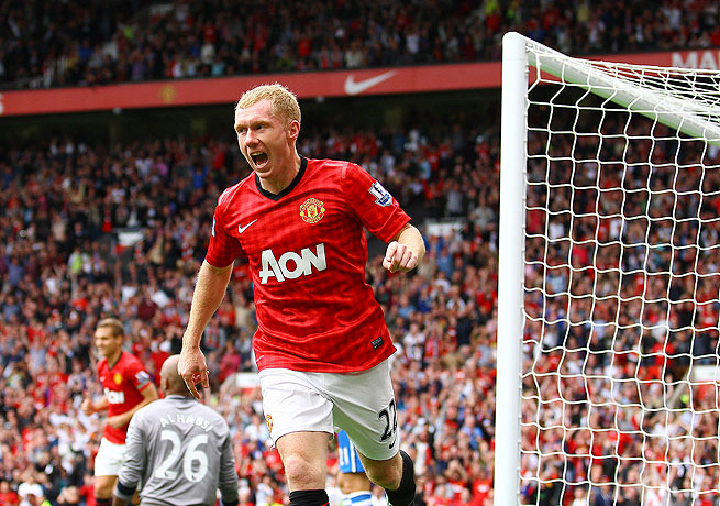 Paul Scholes, seen here after scoring against Wigan, has spent his whole career at Manchester United.