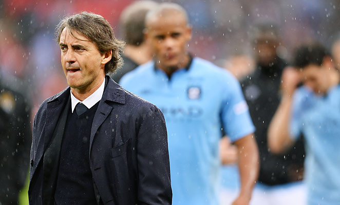 Roberto Mancini led Manchester City to the EPL title last season, but finished second in 2013.