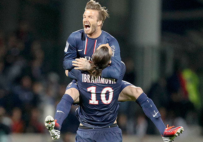 David Beckham and Zlatan Ibrahimovic celebrate PSG's first league title in 19 seasons.