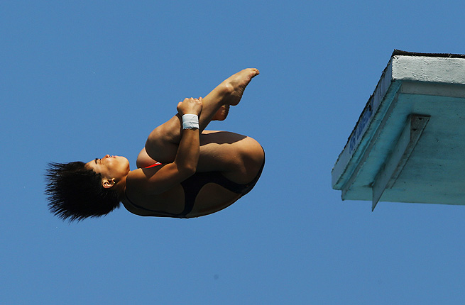 Huang Xiaohui of China dives during the Women's 10 Meter Platform Finals of the FINA USA Diving Grand Prix.