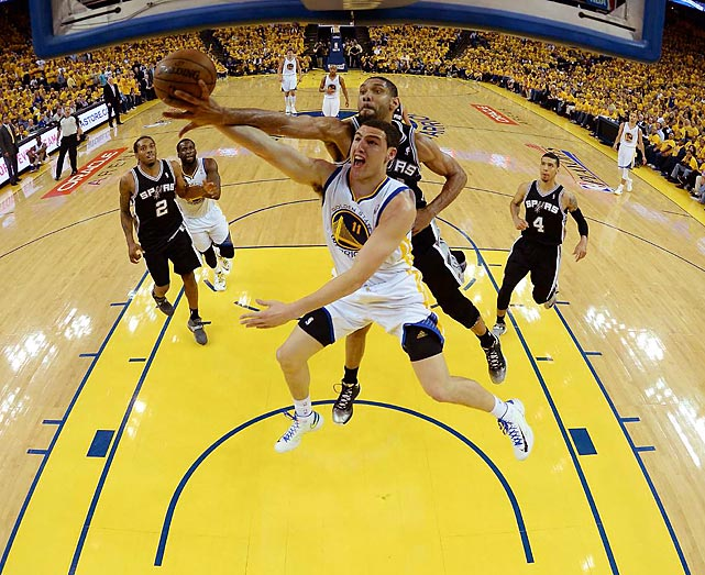 Golden State's Klay Thompson (11) and San Antonio's Tim Duncan battle for the ball during Game 2 of their second-round series Friday at Oracle Arena in Oakland.