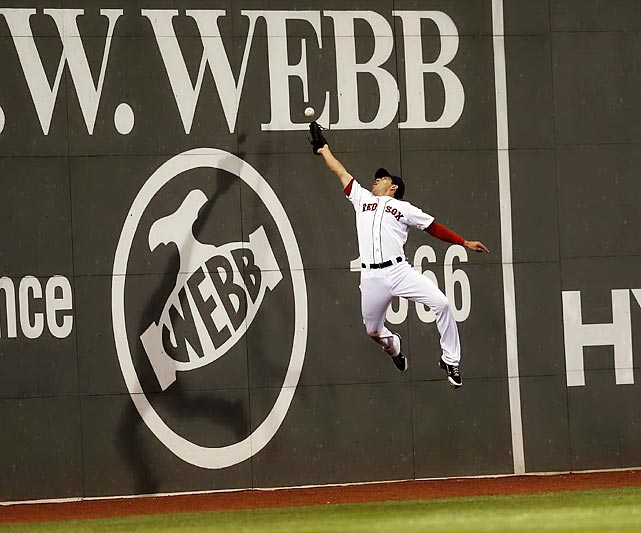 Red Sox center fielder Jacoby Elisbury leaps for a fly ball in Wednesday's 15-8 loss to the Twins at Fenway Park.