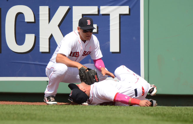 Shane Victorino ran hard into the low wall at Fenway Park while pursuing a home run Sunday.