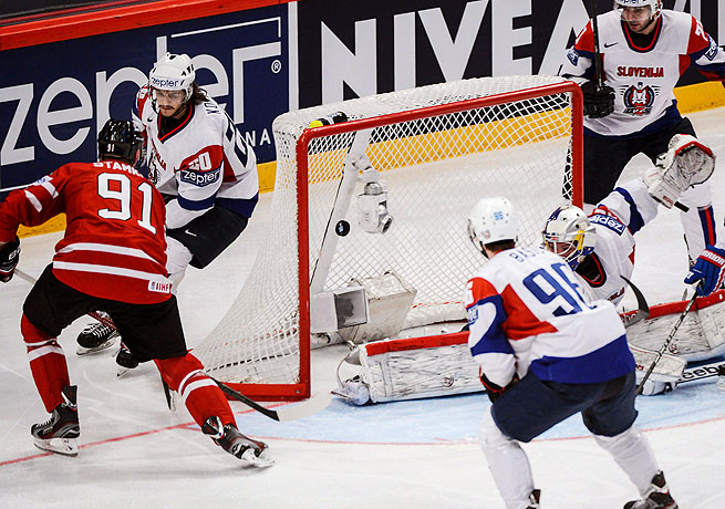 Canada's Steven Stamkos scores against Slovenia to tie the game in the second period on Monday.