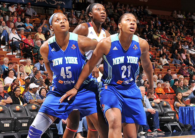 New York Liberty's Kara Braxton (left) and Alex Montgomery box out Connecticut Suns' Tina Charles.