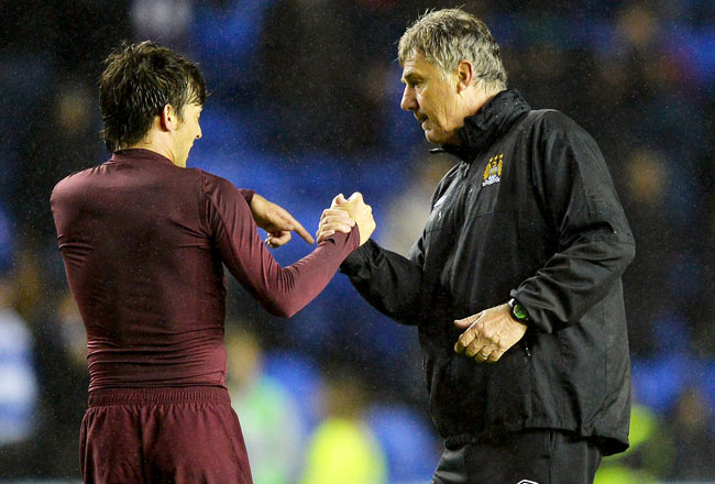 Interim manager Brian Kidd congratulates David Silva after a 2-0 victory at Reading.
