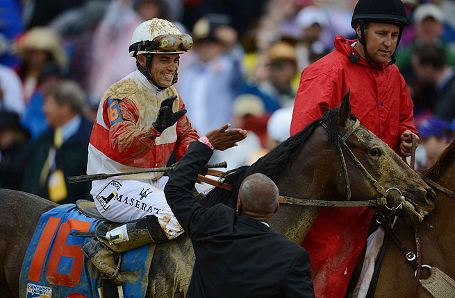 Jockey Joel Rosario atop Orb celebrates after winning the Kentucky Derby on May 4.