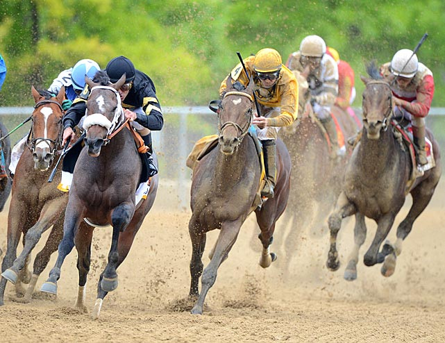 Oxbow (second from left), was sent off at 15-1 odds and led from the start with 50-year-old jockey Gary Stevens aboard.