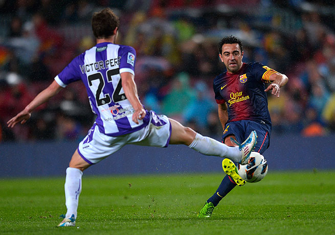 Barcelona's Xavi attempts a pass during his team's victory over Real Valladolid.