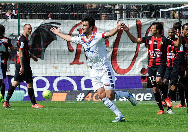 Clement Grenier celebrates his game-tying strike for Lyon against Nice.