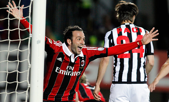 Giampaolo Pazzini celebrates AC Milan's dramatic win, which sends them to next year's Champions League.