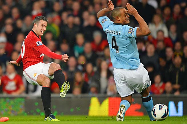 Robin van Persie (left) starred in his United debut, taking the trophy from Vincent Kompany's City.