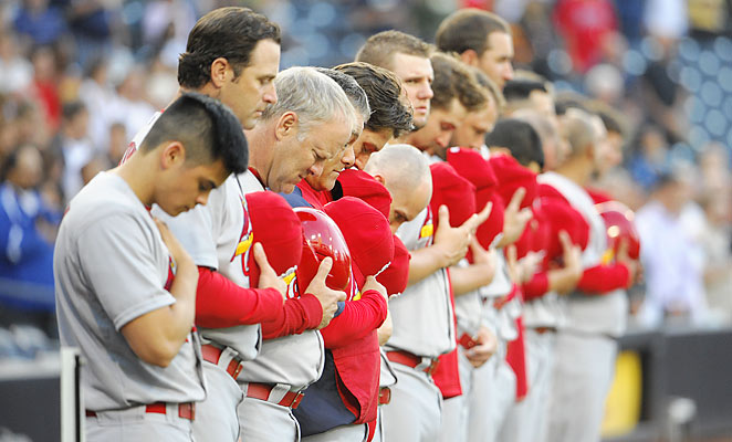 St. Louis Cardinals players and staff observed a moment of silence before playing the San Diego Padres.