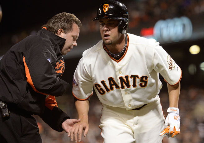 Ryan Vogelsong grimaced in pain and grabbed his hand after fouling off a pitch in the fifth inning.