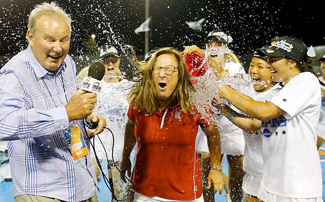 Stanford players dump water over head coach Lele Forood's head.