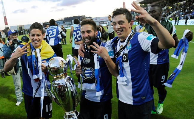 James Rodriguez (left) and Joao Moutinho (center) celebrate after Porto won the Primeira Liga.