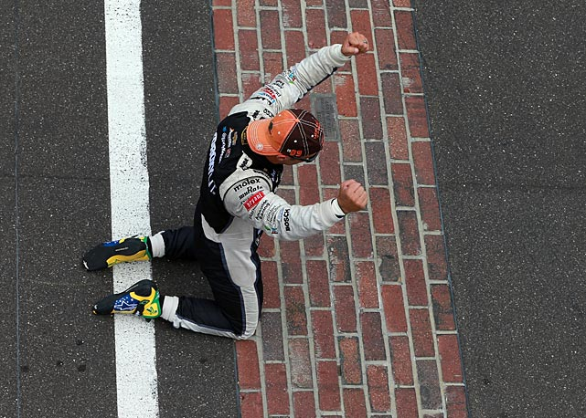 Kanaan reacts after kissing the bricks after winning the IZOD IndyCar Series 97th running of the Indianpolis 500.