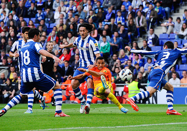 Alexis Sanchez of Barcelona slots home his team's opening goal against Espanyol.