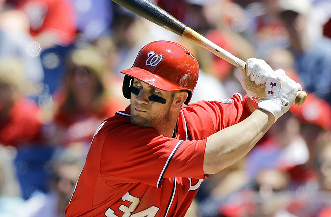 Outfielder Bryce Harper aggravated his sore left knee three times in Sunday's 6-1 win over the Phillies.