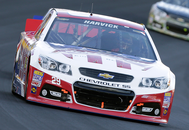 Kevin Harvick used a late restart to overtake Kasey Kahne and win his second Coca-Cola 600.