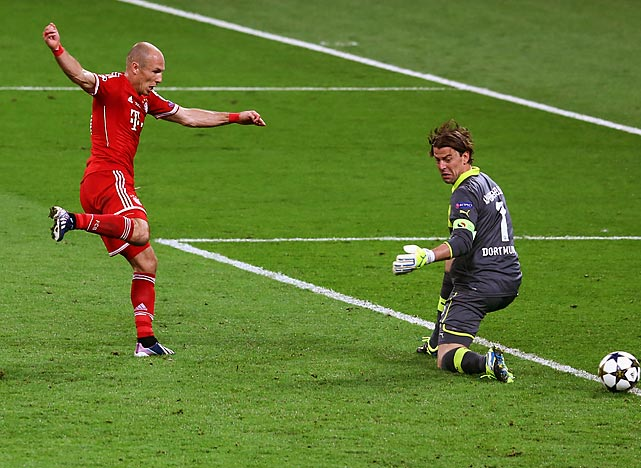 Bayern Munich's Arjen Robben slips the game-winning goal past Borussia Dortmund keeper Roman Weidenfeller during the UEFA Champions League final in London. Robben's 89th minute goal clinched Bayern Munich's 2-1 win.