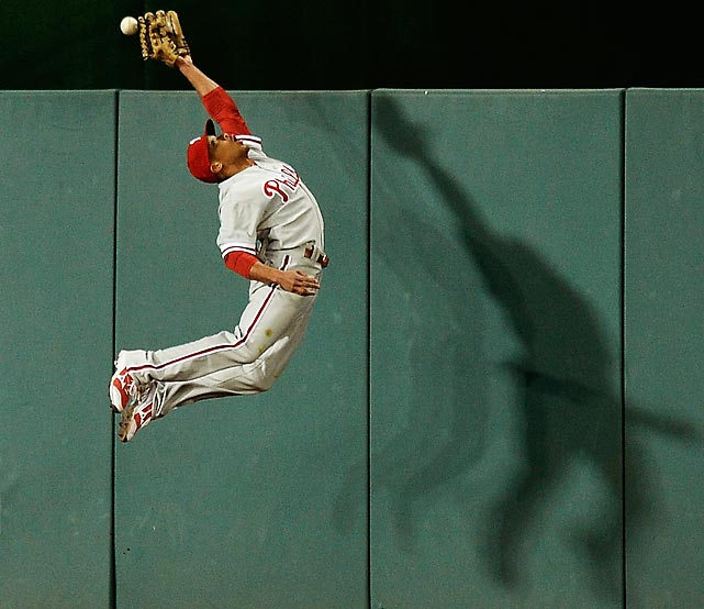 Phillies outfielder Ben Revere leaps but narrowly misses an RBI triple off the bat of the Nationals' Adam LaRoche.