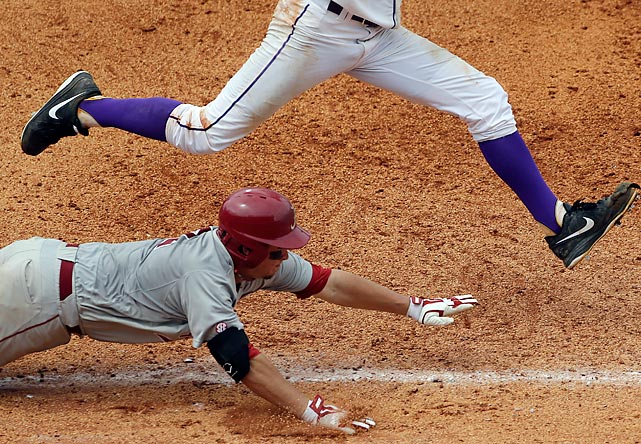 LSU pitcher Cody Glenn beats Alabama's Andrew Miller to first base in the seventh inning of an SEC Tournament game.