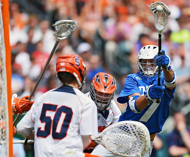 Duke's Jake Trupicka shoots and scores on Syracuse goalie Dominic Lamolinara during the national championship game in Philadelphia. Duke clinched the game and the national title by a score of 16-10.