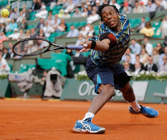 Gael Monfils returns a shot from fifth-seeded Tomas Berdych during a first-round match of the French Open. Monfils won a five-set thriller that took over four hours.