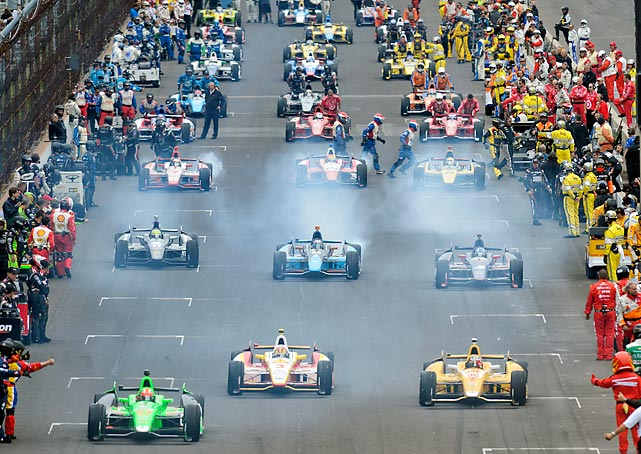 IZOD Indycar racers start their cars at the 97th running of the Indianapolis 500.