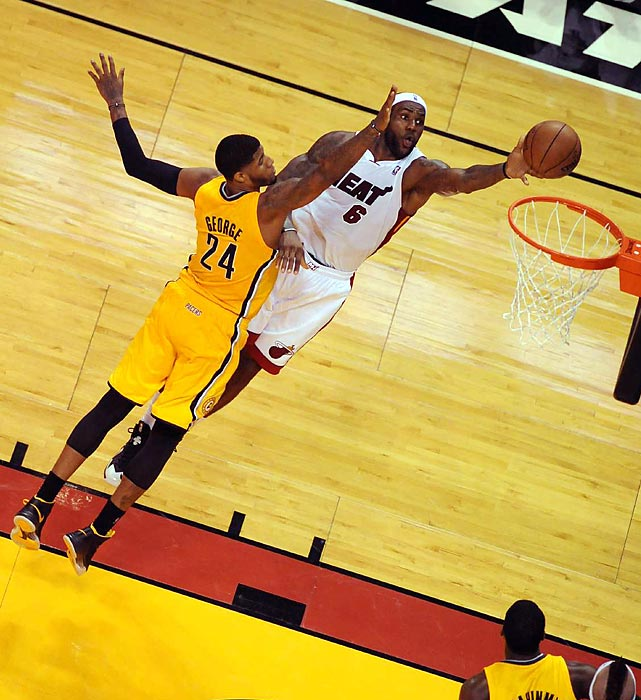 LeBron James goes flying toward the rim over Indiana's Paul George during Game 1 of the Eastern Conference Finals.