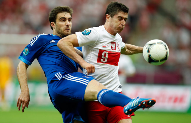 Sokratis Papastathopoulos (left) would be teammates with Robert Lewandowski, if the striker stays.