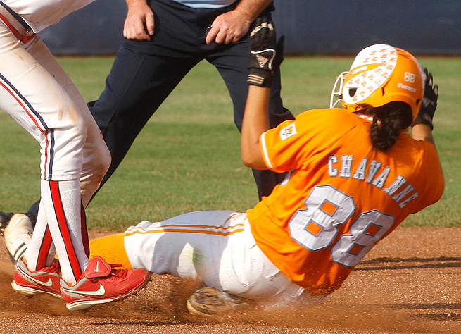Raven Chavanne slides under the tag of the Arizona shortstop during the 2010 College World Series.