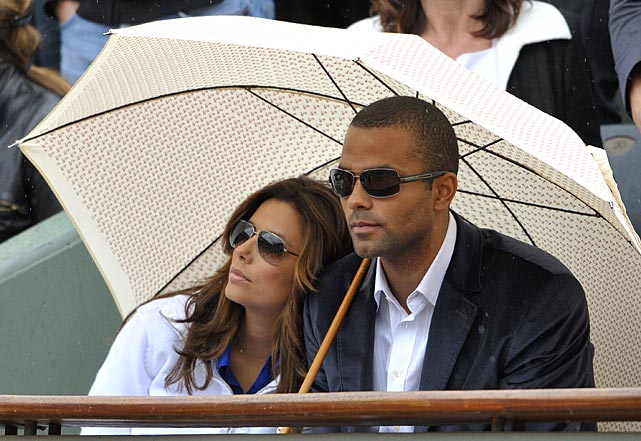 The Parkers watch the 2009 French Open final match between Roger Federer and Robin Soderling at Roland Garros Stadium in Paris.