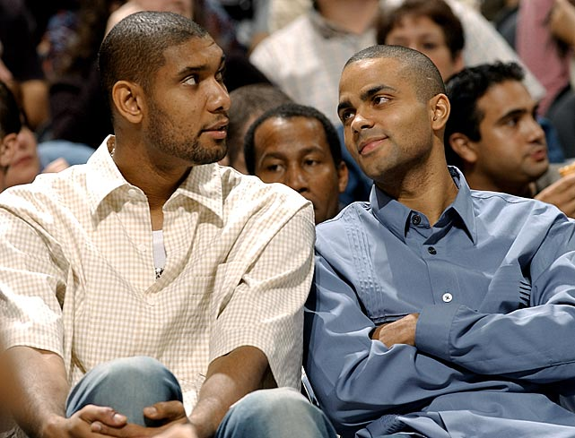 Injured stars Duncan and Parker watch their teammates play the Miami Heat in November 2003. (The Spurs, incidentally, were fined $250,000 in December 2012 for not bringing Parker, Duncan, Ginobili and Danny Green to a game against Miami.)