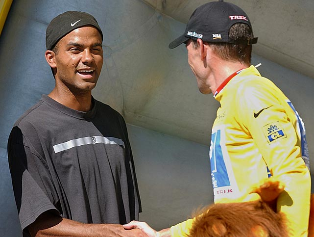 Parker winks at overall Tour de France leader Lance Armstrong after the 12th stage of the race.