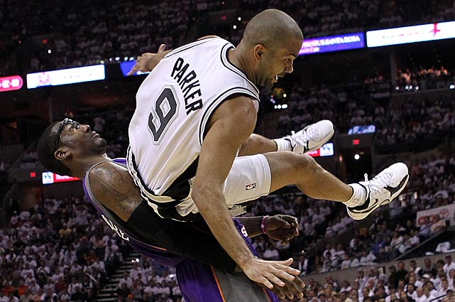 Parker draws a foul by Phoenix's Amar'e Stoudemire during Game 3 of the Western Conference semifinals in 2010. The Spurs were swept in the series.