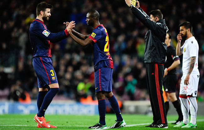 Eric Abidal (center) returned in April after undergoing a liver transplant.