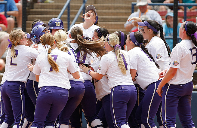 Washington celebrates Kimberlee Souza's walkoff home run in the opener of the Women's College World Series.