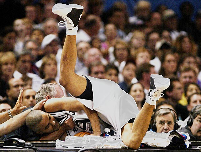 Parker dives onto a courtside table while trying to grab the ball during a championship game against the New Jersey Nets.