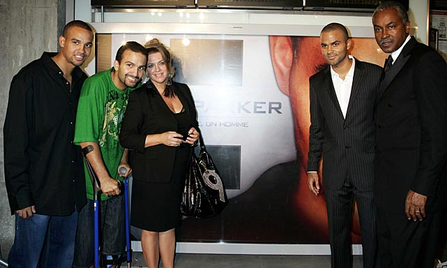 Pierre and Terence Parker, Pamela Firestone, Tony Parker and his father, Tony, pose for a photo during the presentation of the documentary on the life of Tony Parker at Publcis Champs Elysees Cinema. Paris.