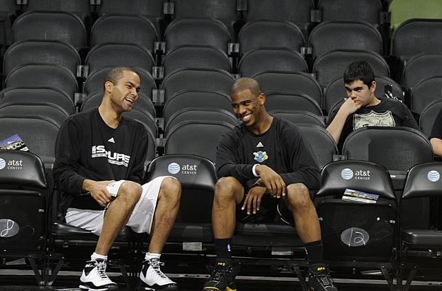 Parker visits with Chris Paul of the New Orleans Hornets a game in San Antonio.