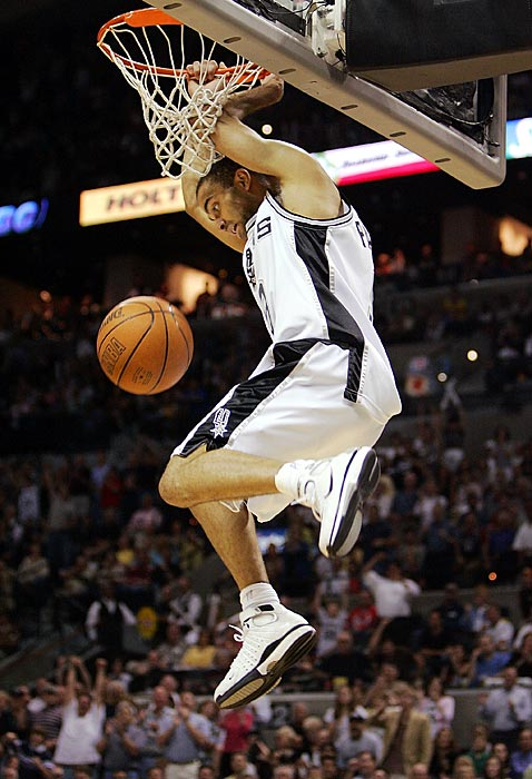 Parker hangs from the rim after dunking against the Seattle SuperSonics in Game 2 of the 2005 Western Conference semifinals. San Antonio advanced in a series that lasted six games.