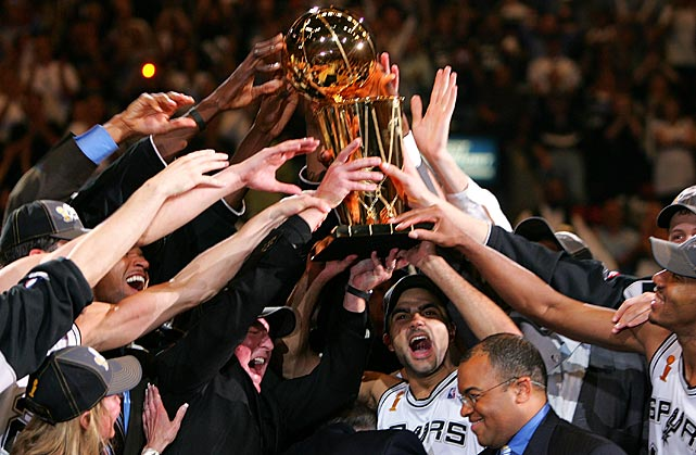 Parker and his teammates hold up the Larry O'Brien trophy after the Spurs defeated the Detroit Pistons in Game 7 of the 2005 NBA Finals.
