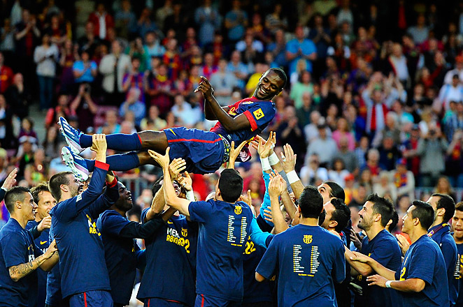 "Barca players wore shirts that said ""Merci Abidal,"" to honor Eric Abidal in his last game with the team."