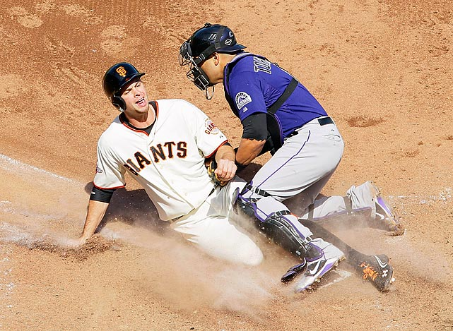 Rockies catcher Yorvit Torrealba gets in Brandon Belt's face as he tags him out at home in the seventh inning of Colorado's 6-5 loss to San Francisco on June 1.
