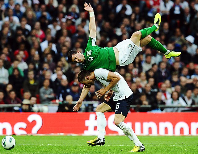 Ireland's Shane Long is sent airborne in a challenge with England's Gary Cahill during an international friendly at Wembley Stadium which ended 1-1.